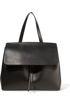 Made from smooth vegetable-tanned leather, the Lady bag is a new spin on your traditional tote—a structured silhouette that can be carried by the top handle or by the attachable, adjustable shoulder strap.   Mansur Gavriel Black Lady Leather Bag; net-a-porter.com