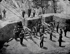 Union soldiers posing with two cannon in the lower battery which protected Chain Bridge in Washington, D.C., 1861.