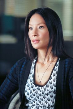 Watson, can I please have your wardrobe? (Lucy Liu as Joan Watson on Elementary) patterned shirt and patterned sweater