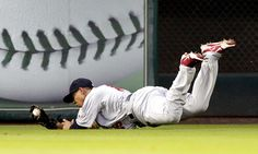 HOUSTON, TX - MAY 04 : Jon Jay #19 of the St. Louis Cardinals makes a diving catch on a hard hit ball by Carlos Lee #45 of the Houston Astros in the second inning on May 4, 2012 at Minute Maid Park in Houston, Texas. (Photo by Bob Levey/Getty Images)