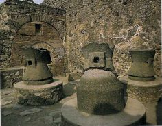 Bakery with multiple mills. Photograph. Pompeii. The Lost World of Pompeii. Los Angeles: Getty, 2002. 73. Print.  This shows how multiple mills would have been within each bakery.