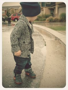 little man in a marled sweater.