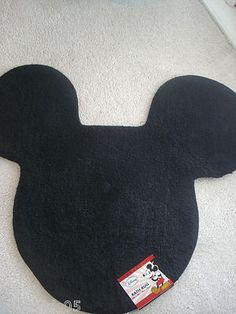 NEW! MICKEY MOUSE AREA RUG. CAN BE USED IN BATHROOM, CHILDS ROOM OR PLAY ROOM. REALLY CUTE!! MEASURES 26in X 30in.--- This is in Cam's Room :) He Loves it!