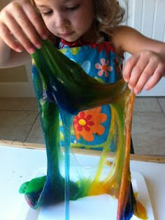 SLIME: 1 1/2 cup clear glue and 1 1/2 cup liquid starch  . . . add food coloring.