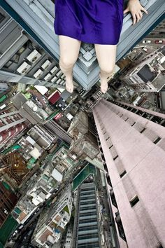 Photographer Jun Ahn, from Seoul, South Korea, has travelled to the top of some of the tallest buildings in her native city, New York and Hong Kong. Once she has climbed to the top of one she will find a suitable location, sit or stand dangerously close to the edge and pose for self portrait photographs.
