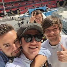here we have in the middle a loving dad taking a photo with his baby boy on his back, then to the right his straight A kid. finally in the back the kid that doesn't think it's cool hanging with the family so just takes awkward background photos with them...