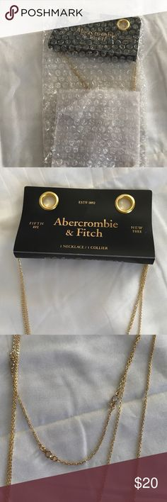 Abercrombie and Fitch multi strand necklace A&F trendy necklace. First strand is clear charms. Second strand is a single bar. Third strand is multi triangles. This is NWT. Pic 1 shows necklace is original packaging & only opened for pics. Abercrombie & Fitch Jewelry Necklaces