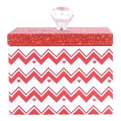 "<P>Keep special trinkets tucked inside this sparkly box around the holidays and all year long. The box features red and white chevron stripes accented with glittery red hearts, and topped with a red glitter lid. Lift the lid by the crystal pull.</P><UL><LI>W 10cm/4"" x H 7cm/3"" <LI>Crystal handle</LI></UL>"