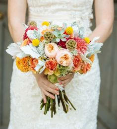 colorful bouquet includes: succulents, craspedia, dahlias + scabiosa pods for a rustic feel - love the idea of carrying a photo