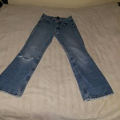GAP JEANS (FLARE) DISTRESSED, SIZE 2 DISTRESSED AND VERY WELL PRE-LOVED WOMEN'S GAP FLARE JEANS, SIZE 2.  HOLE IN ONE KNEE, HOLE UNDER ONE REAR POCKET (BUTT) SMALLER HOLE UNDER BASE OF ZIPPER, FRAYING ON ENDS OF LEGS. GAP Jeans Flare & Wide Leg