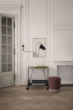 GUBI // Matégot Trolley, Beslite BL10 Wall Lamp, Andet Rectangulaire Mirror and GUBI Pouffe