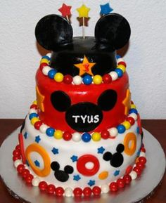 Homemade Mickey Mouse 3 Tier Cake: I made this Mickey Mouse 3 Tier Cake for my son's third birthday party. He loves Micky Mouse.  I baked two tiers in round pans and the third (Mickey hat)