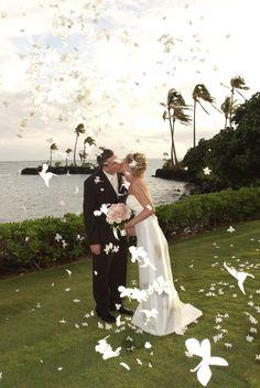 A flower shower for the couple at the Diamond Head Gazebo at the Kahala Resort. Photo by Arna Johnson. Wedding planning by Tori Rogers www.hawaiianweddings.net