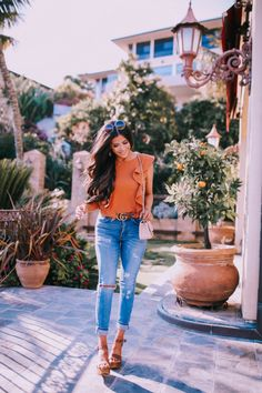 Casual outfit for spring, jeans, sandals and an orange top! Emily Gemma, Fashion Outfit #EmilyGemma #fashion #springstyle #fashiontrends #FashionBlogger