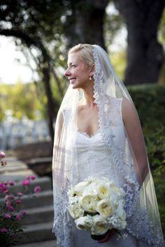 Elegant bride with stunning white bouquet - photo by Ashley Garmon Photography  | via junebugweddings.com