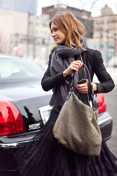 STYLE FILE: Great weekend style on Natalia Vodianova, casual and chic. Note the way the scarf is wrap-tied with her monochrome look.