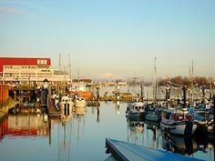"""Steveston Village, BC. A nice day trip from Vancouver. Eat lunch at a restaurant on the wharf, browse the shops, go on a whale watching boat tour or stroll through the town looking for landmarks from the movies and television shows shot here (e.g. """"Once Upon a Time"""")."""