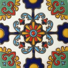 Our Otono Malibu Style tile features a wonderful stylized floral design with blue tones in turquoise, white, cobalt blue, with green & gold highlights.