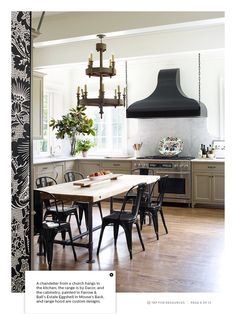 Love the matte black hood and cabinet paint (Farrow & Ball's mouse's back).