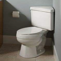 Corner toilet.  This may be the solution.