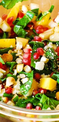 Perfect Fall Salad: Chopped salad with spinach, pomegranate seeds, mango, apples, pears, hazelnuts, and Gorgonzola cheese. #Thanksgiving