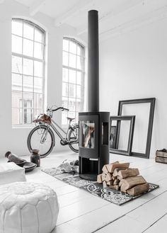 CURRENTLY MUSING // S A L A D D A Y S-  this loft space, tall windows and little fireplace