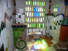 Inside the Hundertwasser toilet block at Kawakawa, Bay of Islands. This is probably the most photographed toilet in New Zealand. It was designed by Austrian born artist Friedenstreich Hundertwasser. Explored 12 Oct 09 Update Now Jet Vac Tanker Hire Mosaic Tile Designs, Mosaic Art, Mosaic Tiles, Friedensreich Hundertwasser, Bottle Wall, Glass Bottle, Wine Bottles, Mosaic Bathroom, Bathroom Wall