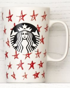 Ceramic coffee mug with a red star pattern. #Starbucks #DotCollection