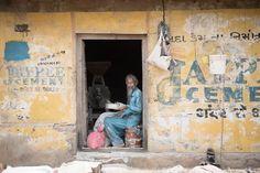 Man making flour in the doorway of his small factory. Khavda, Gujarat, India.