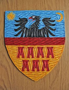 quilled coat of arms