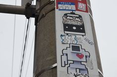 a lovebot sticker on a TTC bus stop pole Robot, Sticker, Art, Art Background, Kunst, Stickers, Performing Arts, Robots, Decal