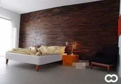 I love the look of recycled distressed wood wall treatments. Wood Slat Wall, Wood Slats, 2x4 Wood, Laminate Tile Flooring, Distressed Wood Wall, Basement Guest Rooms, Into The Woods, How To Distress Wood, Wall Treatments