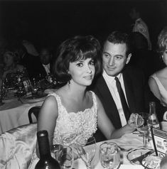 Photo of Gina Lollobrigida and Rock Hudson at Pat Boone's opening at the Cocoanut Grove in Hollywood, California. 1964