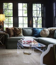 the sectional/ L-shaped sofa + Lucite coffee table