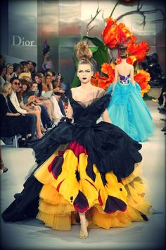 galliano, black, yellow, 50's inspired dress: I love the different textures and the asymmetry of this dress.  I love the use of the contrast in color.