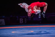 Gurami KHETSURIANI (GEO) peforms an athletic flip after winning the Greco-Roman 87KG Gold Medal.  Photo by Sachiko Hotaka. Olympic Wrestling, Sport Photography, Geo, Olympics, Cool Pictures, Roman, Competition, Athletic, Photo And Video