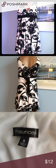 H.P.MAURICES DRESS JUST REDUCED BLACK AND WHITE SUNDRESS WITH PADDED BRA AND A TIE IN BACK. V NECK IN FRONT AND IS FULLY LINED. FRONT HAS A GATHERING RIGHT AT THE WAIST TO GIVE YOU MORE ROOM. VERY CUTE AND IN GOOD CONDITION. THANK YOU TO @janicegw FOR THIS HOST PICK FOR STATEMENT STYLE! MARICES Dresses