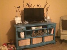 Repurposed old dresser into a entertainment center