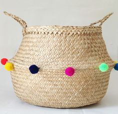 Beautiful and practical handwoven sea grass baskets adorned with fun pom poms! Inspired by the colour and beauty of traditional textiles and