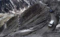 Srinagar-Leh road link open for vehicular traffic after five months closure. Vehicles drive near Zojila pass, 108 kilometers miles) east of Srinagar, the summer capital of Kashmir, India Srinagar Tourism, Go Rider, Kashmir India, Dangerous Roads, On The Road Again, Suspension Bridge, The Eighth Day, Leh, Royal Enfield