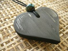 kokoro Bamboo Charcoal Pendant from the Charcoal People. kokoro means heart - an ever popular shape with either red or turquoise bead. Romantic yet understated. 3.8cm. Visit www.charcoalpeople.co.uk/buy_pendants.htm to purchase.