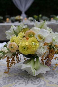 (Belmont/Peaches centerpieces) http://ariellaflowers.com/files/gimgs/13_s15.jpg