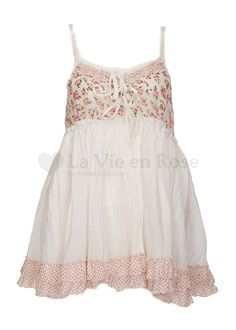 NUNZIA TOP by Nadir Positano    Product Code: NUNZIA  Item ID: 2601  La Vie en Rose Price: £100    Nadir at La Vie en Rose Boutique. Another versatile top from Nadir, the Nunzia is a little strappy number in a combination of plain cream cotton and floral print trimmed with a polka dot ruffle hem.  My favourite way to wear it is with the ties at the back with the Zambia pants.