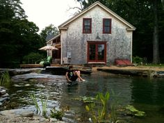 """natural swimming pool . stone """"sunken patio"""" bottom, and a """"floating stone"""" diving platform . Water House Pools"""