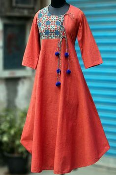 Buy Maati Crafts Red Cotton Anghrakha Kurti online in India at best price.a stunning evening dress, styled like a mughal inspired anghrakha with woollen fumdas at the end of dori. Pakistani Dresses, Indian Dresses, Indian Outfits, Salwar Designs, Blouse Designs, Hijab Fashion, Fashion Outfits, Indian Designer Wear, Mode Inspiration