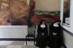 Hunger games: Nuns sit at a fast food restaurant downtown of Guatemala City August 28./Reuters