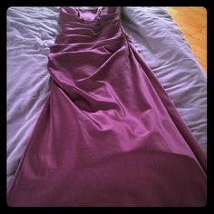 Beautiful Fitted Gown I wore this eggplant long silky dress to my best friend's wedding. It's perfect for an elegant evening or for a bridesmaid. Super comfortable, slight sweetheart shaped strapless top, ruching is very flattering on any body type. I've only worn this dress once and know it will make someone feel beautiful! Dresses Strapless