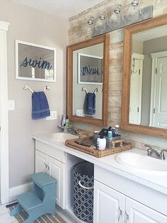 Gorgeous ideas for coastal bathroom decor. Get a nautical look in your home including a faux plank wall.