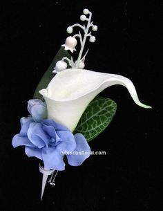 White real touch calla lily and blue hydrangeas groom's boutonniere  This would be perfect!