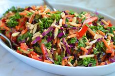 TESTED & PERFECTED RECIPE- This salad of earthy kale; crunchy carrots, bell peppers, cabbage & toasted almonds has bright flavors and textures.